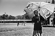 NAIROBI, KENYA - JANUARY 2, 2008: A displaced Kenyan girl seeks shelter with her family in a stadium near the Nakuru showgrounds. A surge in violence left scores of people dead in Nairobi as defeated presidential candidate Odinga prepared to declare himself head of state, after rejecting the victory of incumbent president Mwai Kibaki.