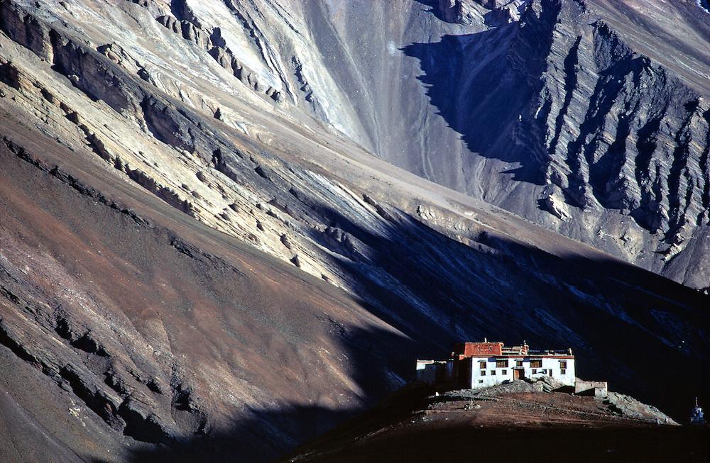 Rangdom Gompa is dwarfed by the imposing shadow of the Himalayas, in Zanskar Valley, India.