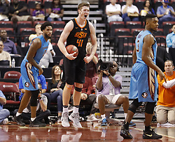 December 16, 2017 - Sunrise, FL, USA - Oklahoma State's Mitchell Solomon (41) reacts as the final horn sounds in a 71-70 win against Florida State during the Orange Bowl Basketball Classic at the BB&T Center in Sunrise, Fla., on Saturday, Dec. 16, 2017. (Credit Image: © Al Diaz/TNS via ZUMA Wire)