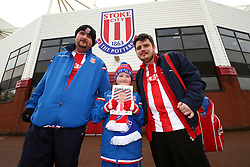 Stoke City fans with a match programme before the Premier League match at the bet365 Stadium, Stoke.