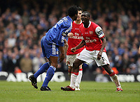 Photo: Rich Eaton.<br /> <br /> Chelsea v Arsenal. Carling Cup Final. 25/02/2007. Kolo Toure right of Arsenal and Mikel John Obi of Chelsea square up and a mass brawl ensues