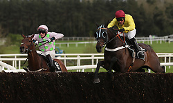 O O Seven ridden by Nico de Boinville (right) clears the last on the way to winning the Guinness Handicap Steeplechase during day two of the Punchestown Festival at Punchestown Racecourse, County Kildare, Ireland.