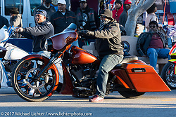 Rolling down Dr. Mary McLeod Bethune Boulevard on a Harley-Davidson for what has come to be known as Black Bike Week during Daytona Bike Week. Daytona Beach, FL. USA. Thursday March 16, 2017. Photography ©2017 Michael Lichter.