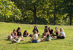 "© Licensed to London News Pictures; 21/09/2020; Bristol, UK. A group of 11 young people sit in Castle Park. Groups of people, some more than six in number, enjoy the sunshine and hot weather on the last official day of summer in Bristol city centre, amid concerns about a second wave of the covid-19 coronavirus pandemic across the UK, with many areas going into local lock down. From Monday 14 September it was illegal to meet up socially in groups of more than six people, known as the ""Rule of Six"", in order to try and contain the spread of the covid-19 coronavirus pandemic, and police have said they will enforce the law with fixed penalty notices which will increase for repeat offenders. Photo credit: Simon Chapman/LNP."