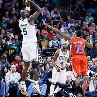 03 February 2013: Boston Celtics power forward Kevin Garnett (5) takes a jumpshot over Los Angeles Clippers point guard Eric Bledsoe (12) during the Boston Celtics 106-104 victory over the Los Angeles Clippers at the TD Garden, Boston, Massachusetts, USA.