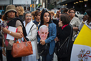 A woman during the Pope's visit, New York, NY on Friday, Sept. 25, 2015.<br /> <br /> Photograph by Andrew Hinderaker