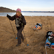Heleen pulls her sledge overland after crossing frozen Lake Baikal in Siberia, Russia on foot. She collected vodka bottles to help clean the lake. .They are a group of five people: Justin Jin (Chinese-British), Heleen van Geest (Dutch), Nastya and Misha Martynov (Russian) and their Russian guide Arkady. .They pulled their sledges 80 km across the world's deepest lake, taking a break on Olkhon Island. They slept two nights on the ice in -15c. .Baikal, the world's largest lake by volume, contains one-fifth of the earth's fresh water and plunges to a depth of 1,637 metres..The lake is frozen from November to April, allowing people to cross by cars and lorries.
