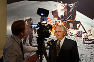 Garden City, New York, U.S. June 6, 2019. HARRISON SCHMITT, Apollo 17 astronaut is interviewed in front of Moon Landing mural, during Cradle of Aviation Museum's Apollo Astronauts Press Conference during its day of events celebrating 50th Anniversary of Apollo 11.