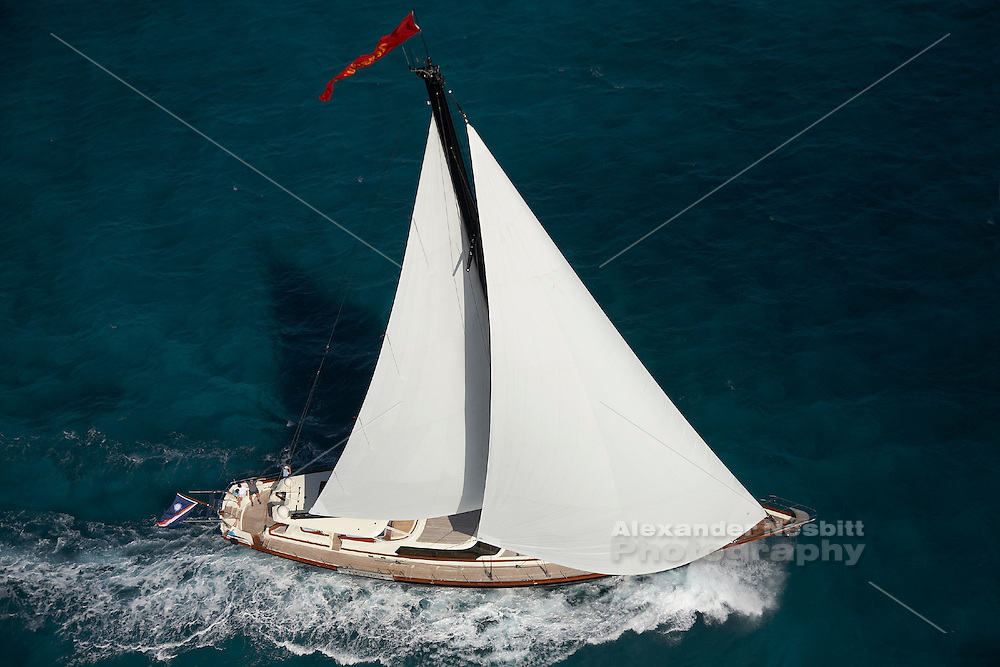 Exumas, Bahamas 2006 - 115 foot Sloop 'Tenacous' sails in the shallow waters off Exumas chaim of islands in the Bahamas.