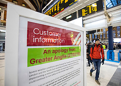 © Licensed to London News Pictures. 27/02/2018. London, UK. A sign in Liverpool Street Station carries an apology from rail company Greater Anglia as commuters attempt to make their way home. Many train services have been cancelled owing to severe weather as the 'Beast from the East' brings freezing Siberian air to the UK. Photo credit: Rob Pinney/LNP