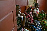 Women wait for the consultation at the HIV/AIDS treatment ward operating under MSF-France in Carnot Hospital, Carnot, Central African Republic. According to Dr. Wilfried Mbolissa, specialist of HIV/AIDS for MSF-France, 75% of the patients are women who come either for prenatal tests or general consultations after getting infected. Most of the infected cases are sexually transmitted from their husbands who leave home for diamond or gold mines; or lack of use of condoms. Some children also come to the services who were infected by their mothers when they were pregnant.