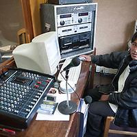 A radio presenter in the cabin of the Lutheran radio station in La Paz.