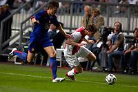 Photo: Daniel Hambury.<br />Ajax v Manchester United. Amsterdam Tournament. <br />05/08/2006.<br />Ajax's Jan Vertonghan and Manchester's Michael Carrick battle.