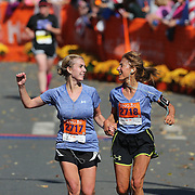 The Finish Line. Expressions of agony and ecstasy on the faces of athletes as mum and daughter Janet Bunke and Melanie Bunke finish the ING Hartford Marathon, Bushnell Park, Hartford. Connecticut. USA. Hartford, Connecticut, USA. 12th October 2013. Photo Tim Clayton