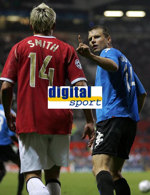 Photo: Paul Thomas.<br /> Manchester United v FC Copenhagen. UEFA Champions League, Group F. 17/10/2006.<br /> <br /> Michael Gravgaard (R) of Copenhagen has words to Alan Smith.