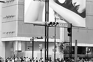 A promotional billboard for Chanel towers over the Sukiyabashi intersection, located in Tokyo's premier shopping district of the Ginza (this billboard is attacted to the Sony Bldg.).