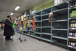 © Licensed to London News Pictures.  20/09/2021. London, UK. Empty shelves are seen in Asda, Stamford Hill in east London as CO2 shortage can hit food suppliers in the UK within days. Photo credit: Marcin Nowak/LNP
