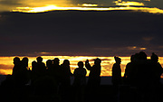 Crowds brave the cold during sunset at Queen Anne's Kerry Park for selfie's and skyline photos , New Years Day, 2017. (Ken Lambert / The Seattle Times)