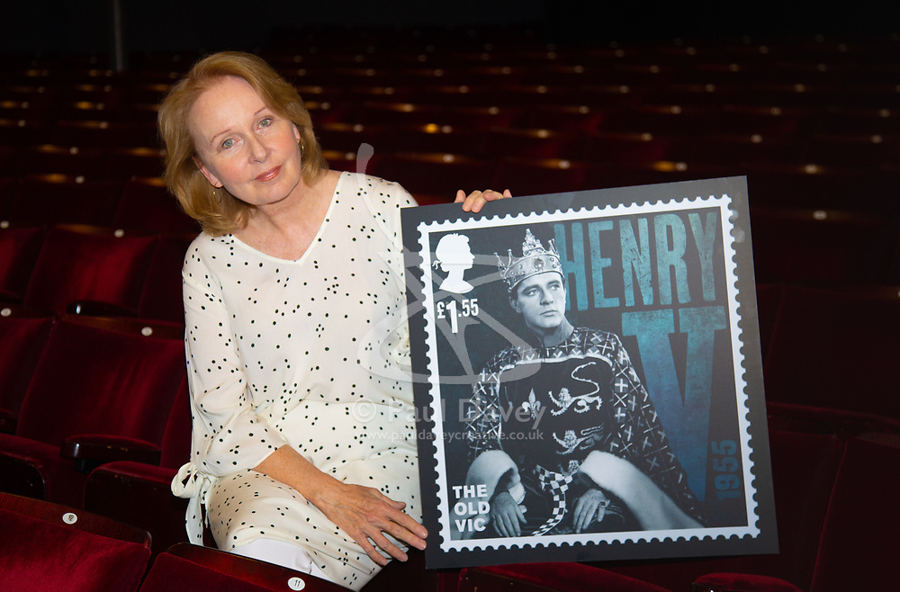 Kate Burton poses in the auditorium with a stamp commemorating The Old Vic theatre. London, August 07 2018.