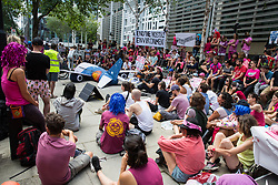 London, UK. 29 July, 2019. Activists from Reclaim the Power, All African Women's Group, Docs Not Cops, Lesbians and Gays Support the Migrants and other groups protest outside the Home Office alongside a model of an aircraft used for deportation flights to demand an end to the Government's 'hostile environment' policies.