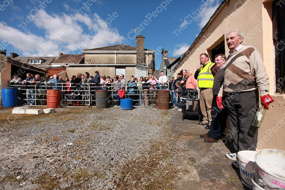 Joe Arkins, Paddy McMahon and Willie Lahiffe at the annual stone throwing competition in the Inchiquin Inn in Corofin on Sunday.<br /> Photograph by Yvonne Vaughan