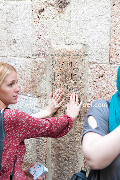 Israel, Jerusalem Old City, Pilgrims at the 6th Station of Via Dolorosa Veronica wipes the face of Jesus