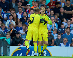BLACKBURN, ENGLAND - Thursday, July 19, 2018: Liverpool's goalkeeper Loris Karius embraces goalkeeper Caoimhin Kelleher as he is substituted during a preseason friendly match between Blackburn Rovers FC and Liverpool FC at Ewood Park. (Pic by David Rawcliffe/Propaganda)