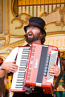 folk singer playing a digital piano accordian at a country steam fair in Yorkshire