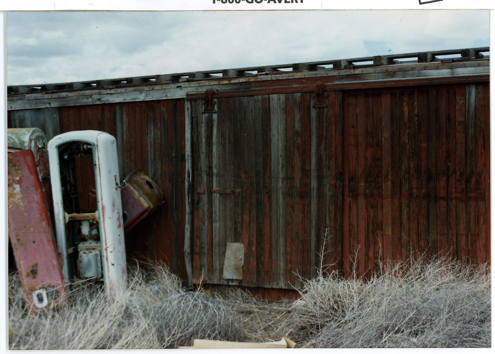 Box car side door detail.  Car being used as storage shed.<br /> D&RGW