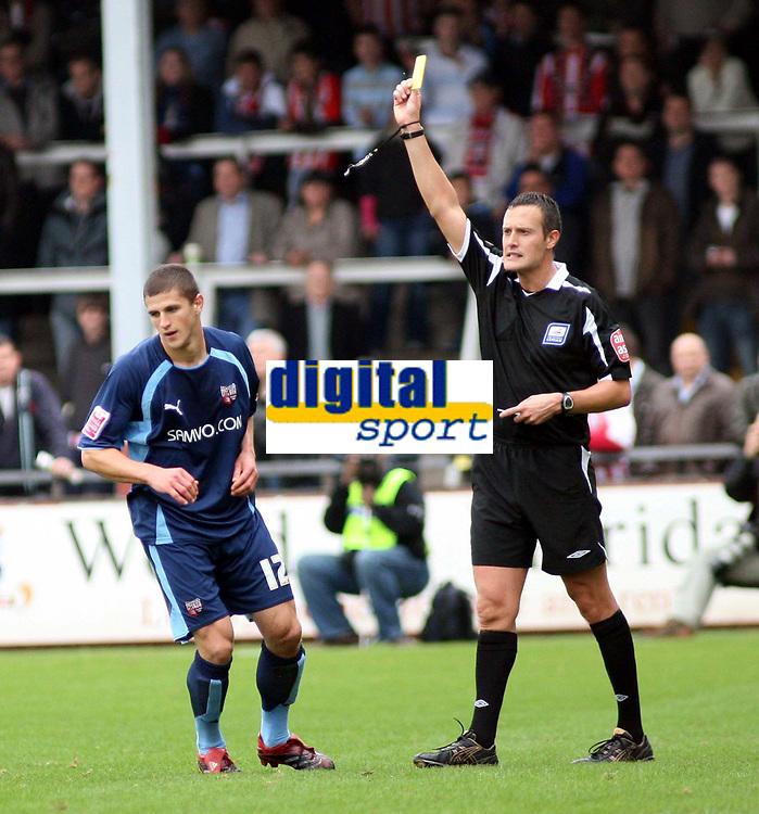 Photo: Mark Stephenson.<br /> Hereford United v Brentford. Coca Cola League 2. 06/10/2007.Brentford's John Mousinho is booked by referee  D Deadman