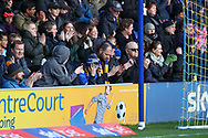 AFC Wimbledon fans with head in hands during the EFL Sky Bet League 1 match between AFC Wimbledon and Peterborough United at the Cherry Red Records Stadium, Kingston, England on 18 January 2020.
