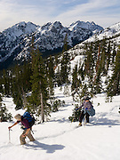 Hikers ascend Ingalls Pass in snow, Alpine Lakes Wilderness Area, Washington, USA