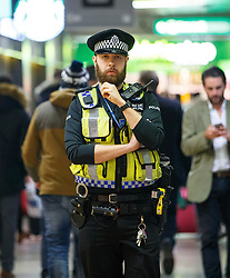 © Licensed to London News Pictures. 07/12/2015. London, UK. Police officers patrolling at Euston station in London on Monday, 7 December 2015. Photo credit: Tolga Akmen/LNP