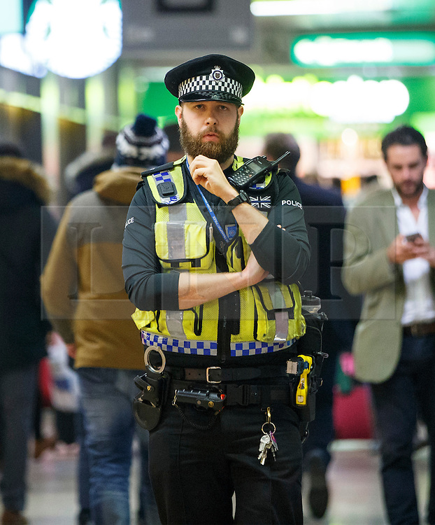 © Licensed to London News Pictures. 07/12/2015. London, UK. Police officers patrolling at Euston station in London on Monday, 7 December 2015. Photo credit: Tolga Akmen/LNP