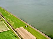 Nederland, Noord-Holland, gemeente Hollands Kroon, 07-05-2021; Polder Wieringermeer, Wieringerwerf. Zuiderdijkweg met het dijkmagazijn in de voorgrond. <br /> Polder Wieringermeer, Wieringerwerf. Zuiderdijkweg with the dike warehouse. luchtfoto (toeslag op standard tarieven);<br /> aerial photo (additional fee required)<br /> copyright © 2021 foto/photo Siebe Swart