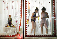 Pine Bush, New York - Two dancers from the Mitchell Performing Arts Center pose in a storefront window during the Pine Bush Festival of Lights on Dec. 4, 2010.