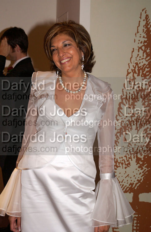 Mrs. Vimla Lalvani, Grosvenor House Antiques fair charity preview in aid of Macmillan Cancer Relief, 10 June 2004. ONE TIME USE ONLY - DO NOT ARCHIVE  © Copyright Photograph by Dafydd Jones 66 Stockwell Park Rd. London SW9 0DA Tel 020 7733 0108 www.dafjones.com