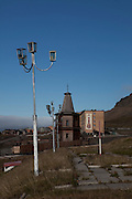"""Russian Orthodox Pomor style church in Barentsburg, a Russian coal mining town in the Norwegian Archipelego of Svalbard. Once home to about 2000 miners and their families, less than 500 people now live here. The church was built as a memorial to the 141 miners and their families that died in a plane crash in 1996, and the year afterward when 23 miners were killed in a mining accident. The Cyrillic text reads """"peace on earth"""", on the mountain behind."""