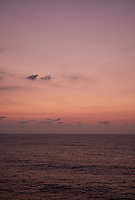 Pastel colored sky and clouds over the Pacific Ocean at dawn.  Image 6 of 21  for a panorama taken with a Fuji X-T1 camera and 35 mm f/1.4 lens  (ISO 400, 35 mm, f/2.8, 1/30 sec). Raw images processed with Capture One Pro and stitched together with AutoPano Giga Pro.