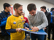 28 DECEMBER 2019 - DES MOINES, IOWA: Mayor PETE BUTTIGIEG, right, signs a signs a placard for a voter during a meet and greet with Buttigieg in Des Moines. Buttigieg talked to a crowd of about 75 people at Urban Dreams, an African-American community empowerment center in Des Moines. It was a part of Buttigieg's continuing outreach to African-American voters. Buttigieg, the mayor of South Bend, Indiana, is running to be the Democratic nominee for President in the 2020 election. Iowa traditionally holds the first presidential selection event of the 2020 election cycle. The Iowa Caucuses are on Feb. 3, 2020.           PHOTO BY JACK KURTZ