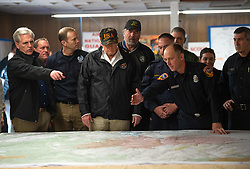 November 17, 2018 - Chico, CA, USA - President Donald Trump listen to Cal Fire Joe Tapia with Congressman Kevin McCarthy during his visit of the Camp Fire in Chico, Calif. on Saturday, November 17, 2018. The Camp Fire in Northern California has become the nation's deadliest wildfire in a century and has killed at least 63 people and left more than 1000 still missing. (Credit Image: © Paul Kitagaki Jr./ZUMA Wire)