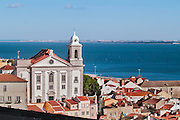 Lisbon, November 2012. Alfama district. View of Santo Estêvão church and Tagus estuary. The church is a National Monument since 1918 and was built in XII century but rebuit in 1733 in baroque style.
