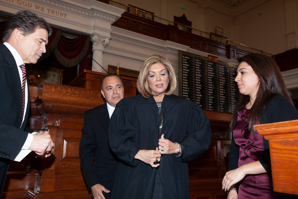 Texas Supreme Court Justice Eva Guzman, is sworn into office by Texas Governor Rick Perry on January 11, 2010 as the first Hispanic female Supreme Court Justice.  Guzman resigned effective June 11, 2021 a move which has prompted speculation she will run for Texas Attorney General against Ken Paxton.