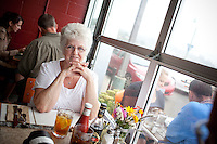 Local Oceans Restaurant in Downtown Newport, Oregon uses fish fresh off the boats from the harbor across the street. Joyce Pirtle enjoys a window seat at the restaurant.