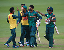 Not out Bangladesh batsmen Mahmudullah (centre) and Mosaddek Hossain celebrate with team mates after winning the ICC Champions Trophy, Group A match at Sophia Gardens, Cardiff.