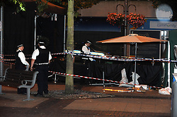 © Licensed to London News Pictures. 22/08/2013<br /> A man has been in stabbed in Bexleyheath this evening. Emergency services were called to the Broadway, near McDonalds, at 8.15pm tonight (22.08.2013)<br /> The man, aged in his late 50s, was treated at the scene before being rushed to a south London hospital with a stab wound where his condition is desribed as stable. <br /> A man was arrested in connection with the incident and has in custody in a south London police station. Police have cordoned off a large section of the Broadway following the incident. <br /> Photo credit :Grant Falvey/LNP