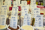 """26 SEPTEMBER 2012 - BANGKOK, THAILAND:  Varieties and grades of rice for sale in Khlong Toey Market in Bangkok. Khlong Toey (also called Khlong Toei) Market is one of the largest """"wet markets"""" in Thailand. The market is located in the midst of one of Bangkok's largest slum areas and close to the city's original deep water port. Thousands of people live in the neighboring slum area. Thousands more shop in the sprawling market for fresh fruits and vegetables as well meat, fish and poultry. Thailand is the world's leading rice producer.    PHOTO BY JACK KURTZ"""