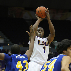 Jan 04, 2010; Baton Rouge, LA, USA;  LSU Tigers forward Tasmin Mitchell (1) shoots over McNeese State Cowboys forward P.J. Alawoya (43) and forward Daniel Richard (54) during the second half at the Pete Maravich Assembly Center. LSU defeated McNeese State 83-60.  Mandatory Credit: Derick E. Hingle-US PRESSWIRE