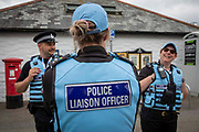 Police liaison officers patrolling the streets around the G7 media centre on the 11th of June 2021 in Falmouth in Cornwall, United Kingdom. Over 5000 police officers from forces across the UK are in Cornwall this weekend for the G7 world leaders summit. Police Liaison officers are supposed to be seen as friendly and approachable, they gather information for their colleagues.