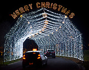 Cars drive through a lighted archway at the entrance to the Way of Lights holiday light display at the National Shrine of Our Lady of the Snows in Belleville on December 3, 2019. This is the 50th anniversary of the annual light display, which runs from 5 pm to 9 pm through December 31. There are also indoor activities including a Christmas tree room, decorated wreaths, and children's craft activities. Carriage rides are also available at the Way of Lights.<br />Photo by Tim Vizer